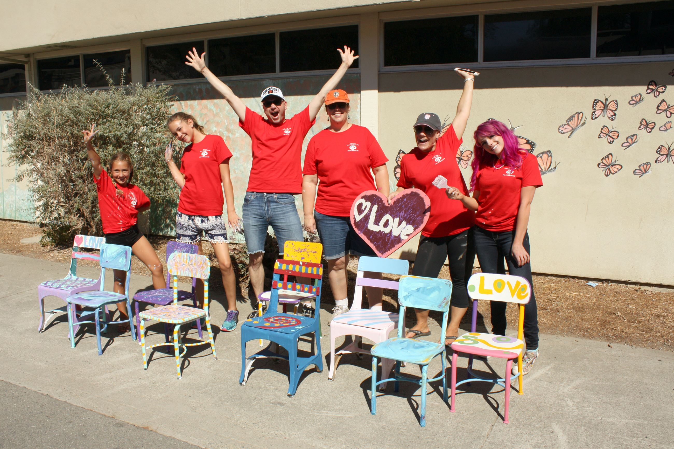 Painting chairs for KidStop at Gregory Gardens Elementary