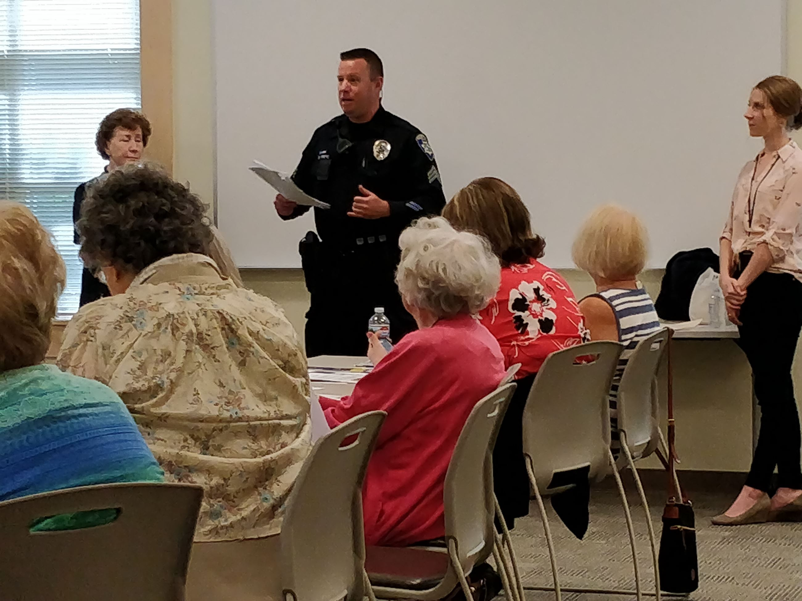 Officer Priebe, Courtney Lee, and Neighborhood Watch Coordinator, Pam Mosher
