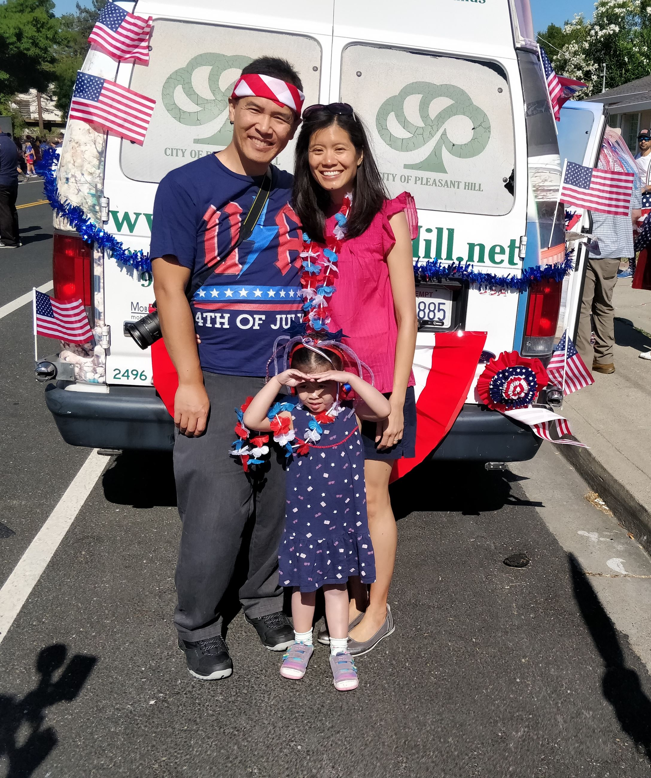 Commissioner Tran posing with his wife and daughter